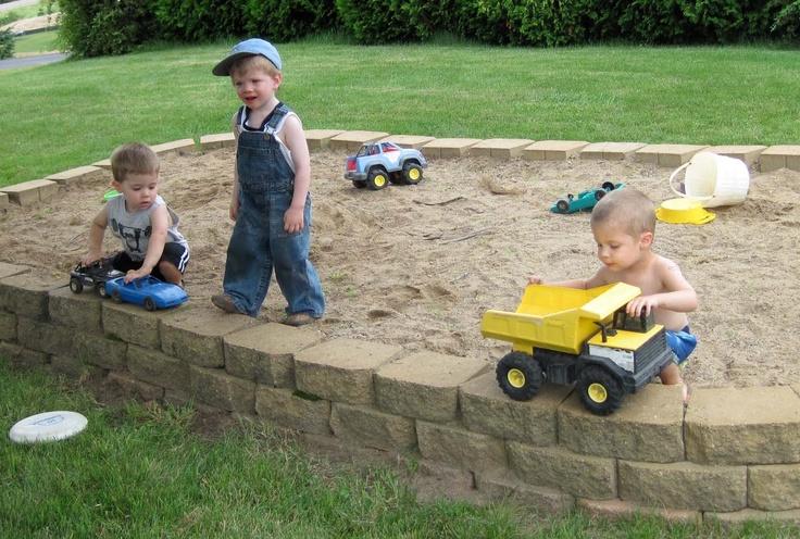 HUGE sandbox built using patio blocks....for Book and Tank?