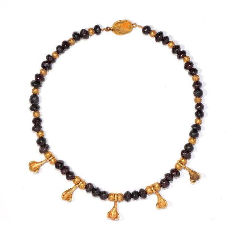 * A Greek Garnet and Gold Pendant Necklace, Hellenistic Period, 3rd - 1st century BC