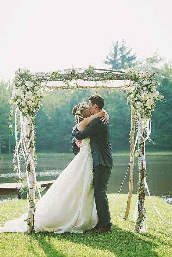 08 birch wedding arch decorated with ribbon and lush flowers - Weddingomania