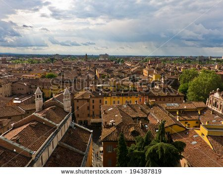 Cityscape of Modena on sunshine after storm, medieval town situated in Emilia-Romagna, Italy (warning: error in a title, this is Modena in Emilia-Romagna, not Lucca in Tuscany) - stock photo