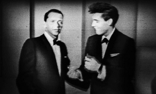 Click on GIF to make Elvis Presley move! Elvis Presley is at the Frank Sinatra special in 1960