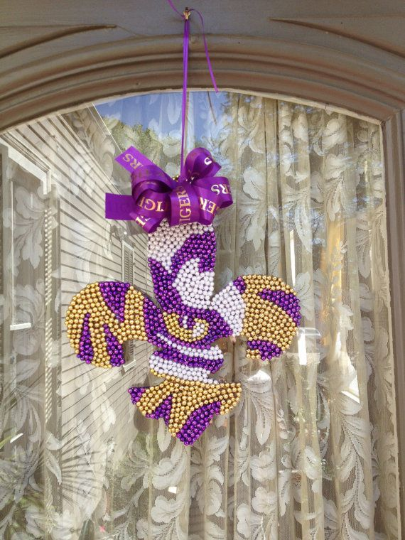 Eye of the Tiger Fleur de lis made with Mardi Gras beads