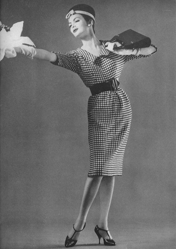 January Vogue 1959    Model is wearing a black and white knitted wool dress by Nettie Rosenstein.