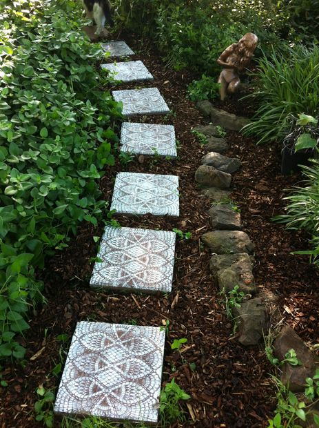 Picture of How to Make Lace-like Stepping Stones- just an old doily or plastic Dollar store doily and a can of spray paint!  Then a top coat of clear sealer