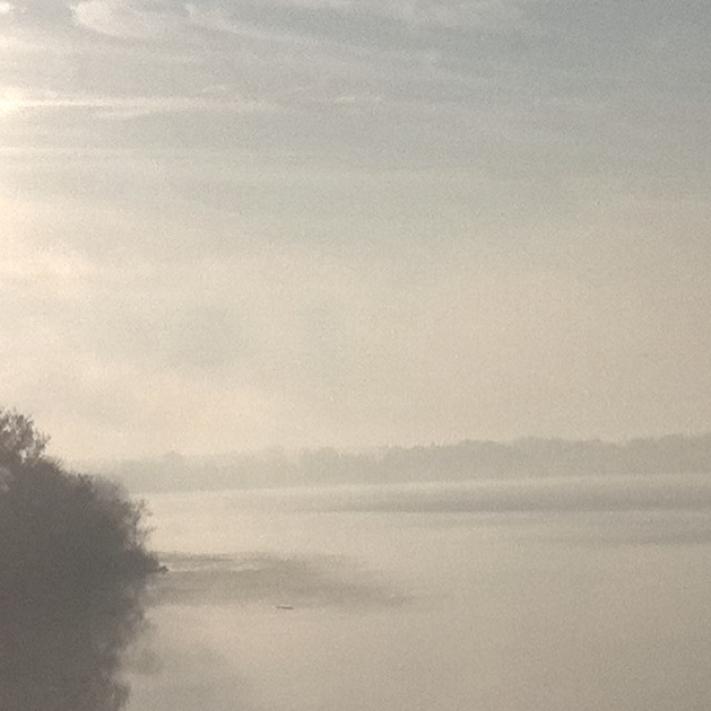 Sunrise on a foggy morning over the river