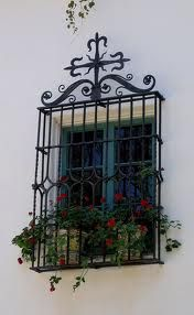 """Reja"" or grille.  Also note the spot-on shade of Moorish green on the window.  Casa del Herrero - House of the Blacksmith. George Fox Steedman's estate. George Washington Smith, arch. Montecito, CAL. 1925."