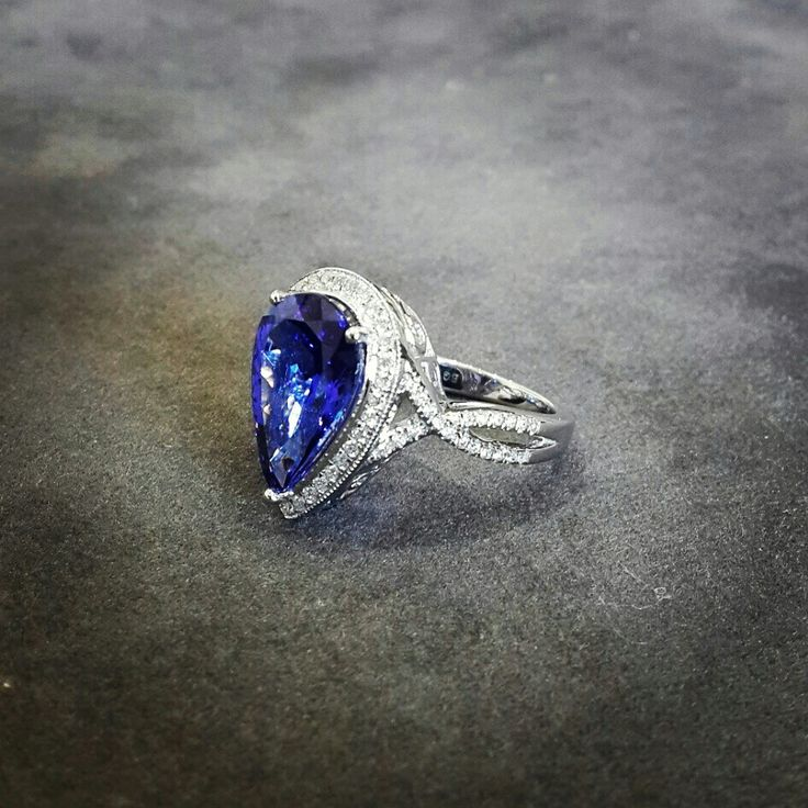 Africn  4ct Pear Tanzanite Set Proudly in Diamonds and Platinum.  Tanzanite - Diamonds - Platinum  Engagement Ring