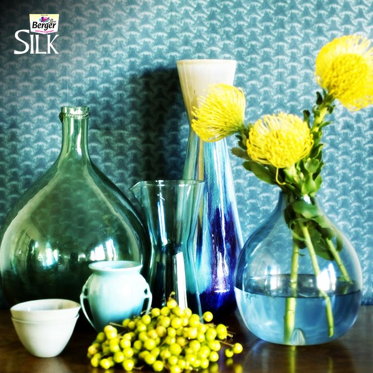Bright flowers in transparent vases are a sure-shot style statement this monsoon.