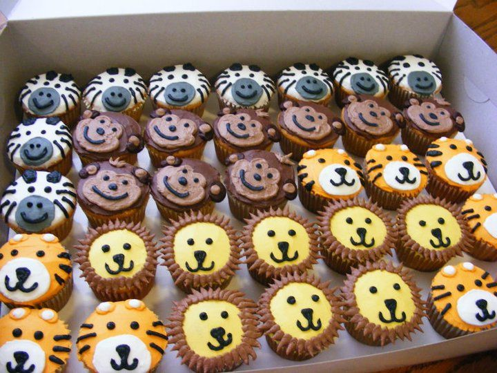 This was for a 1 year birthday party. 3D lion smash cake with animal faces cupcakes. Made with all buttercream icing.