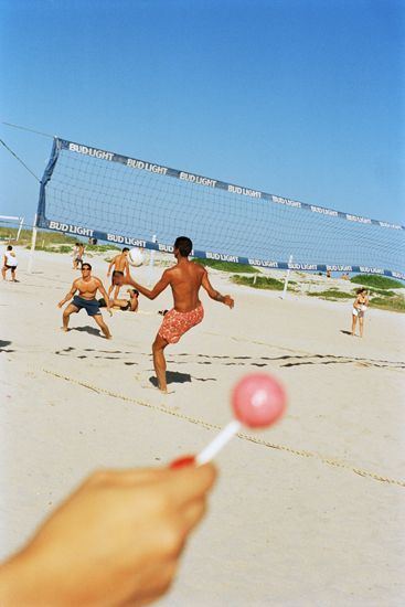 Martin Parr Photography: i really enjoy this image, as it is very vibrant and has an amazing feel to the image. i also like how the womens hand is out of focused and the lolly pop distracts the viewer from the overall image