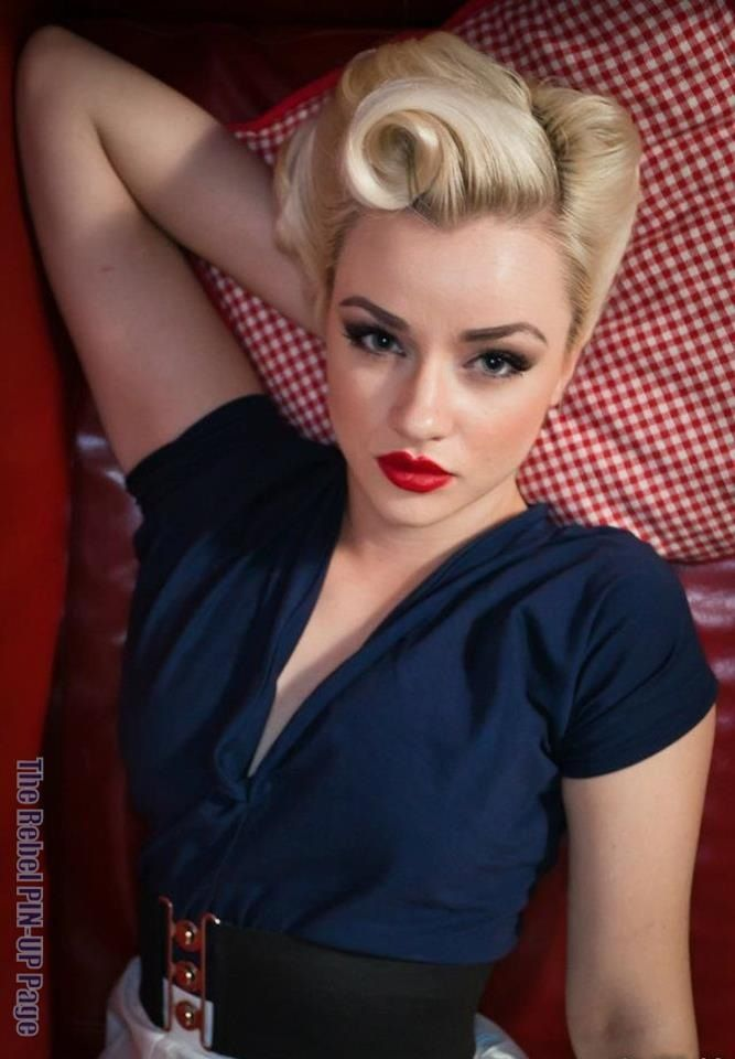 This is exactly the look I want for the wedding. Victory roll/ pin curls ... Smoky eyes and red lipstick.