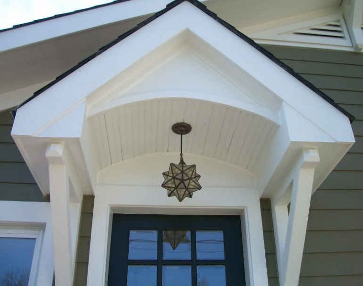 AFTER: Close-up pic of front door showcases the intricate details of the incredible arched portico, and amazing hanging light fixture, which adds a small modern touch to the home (without taking away from the traditional feel of the Craftsman style). This remodel has JUST the right balance of contemporary and classic!