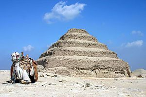 The Pyramid of Djoser (or Zoser), or step pyramid (kbhw-ntrw in Egyptian) is an archeological remain in the Saqqara necropolis, Egypt, northwest of the city of Memphis. It was built during the 27th century BC for the burial of Pharaoh Djoser by Imhotep, his vizier. It is the central feature of a vast mortuary complex in an enormous courtyard surrounded by ceremonial structures and decoration.