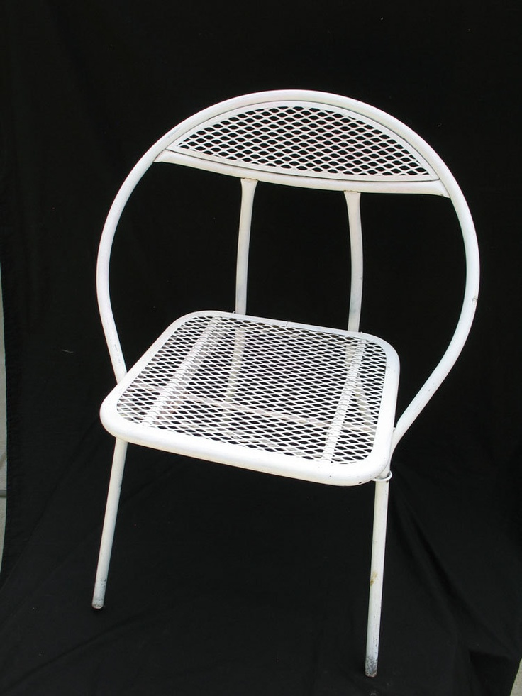 Vintage Salterini Style Metal Garden Chair  Mid Century Modern Shabby White Foldable Chair. $60.00, via Etsy.
