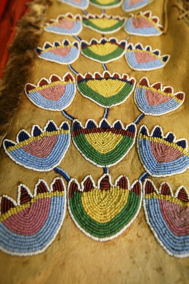 A beaded detail of a hide coat A beaded detail of a hide coat from the Dyck collection at the Plains Indian Museum in Cody WY. The coat will be restored but won't be part of the exhibit opening in June.