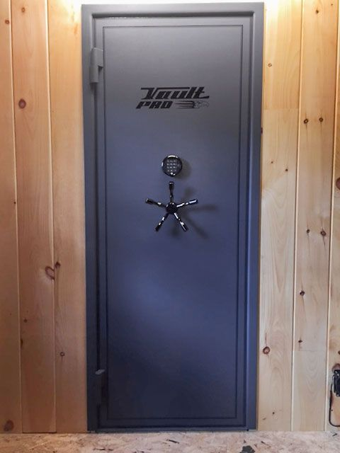 Vault door custom installation with wood paneling gun for Custom safe rooms