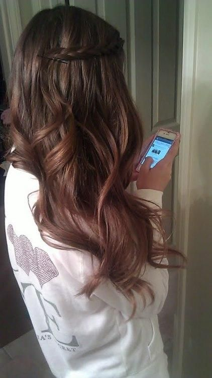 Easy hairstyle with a braid and a bobby pin. Would be cute with loose curls or straight hair