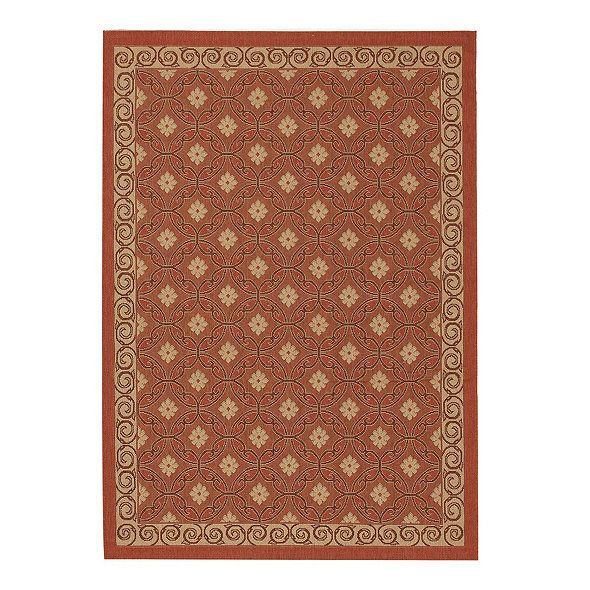 The Ravello Indoor/Outdoor Rug has a Mediterranean tile motif and is hand tufted in graded shades of color to create a rich dimensional look.
