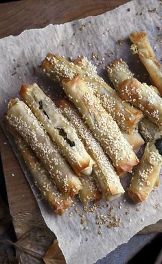 Golden baked spinach and feta filo fingers sprinkled with sesame seeds. Try this recipe as a starter or as part of dips before dinner.