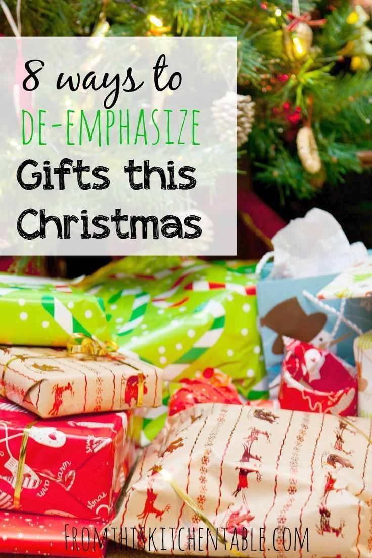 Is it Christmas without piles of presents under the tree? These are 8 great ideas to help your family take the emphasis off of gifts. Need to read this for this year! #christmas #presents #frugal #saving #traditions #debtfree