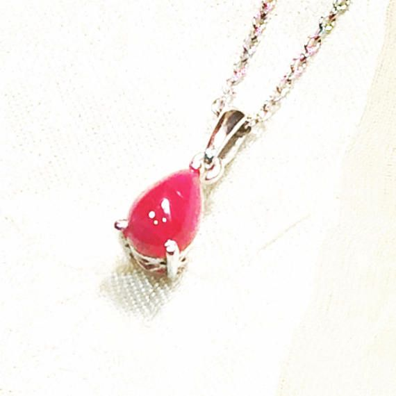 This 2.25CT ruby cabochon makes the perfect teardrop of love, set in platinum over sterling silver. Ruby is said to unlock integrity, devotion, happiness, healing, courage, passion, enthusiasm, generosity, inspiration, prosperity, high energy, power and leadership. It is the 40th