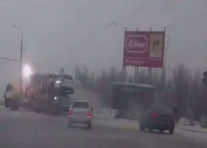 Check out this Russian dash cam footage of a driver losing control, fishtailing, and colliding into power lines.