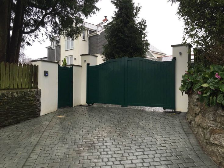 this is a dark green aluminium driveway and pedestrian gate finished in the same ral colour
