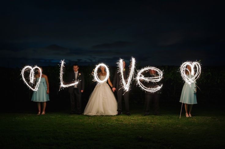 Sparkler photo with wedding party. 'Love' this one!