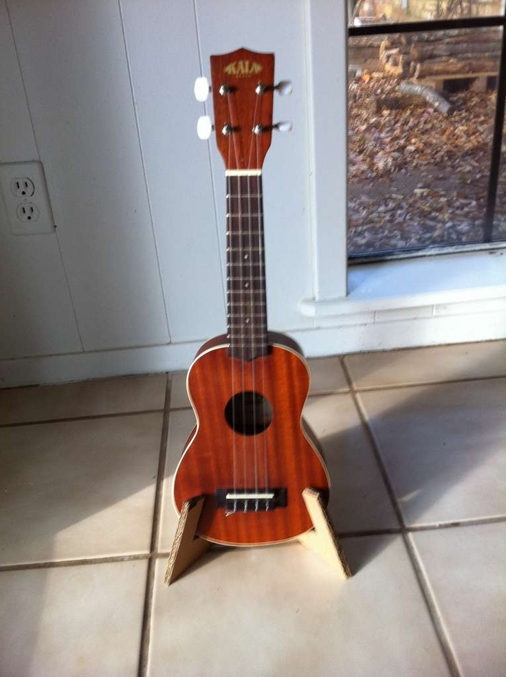 Cardboard ukulele stand.--wonder if this could be made in wood