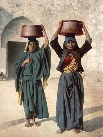 A century-old photochrom print, showing Arab village-girls selling milk near the gate of the old city of #Jerusalem
