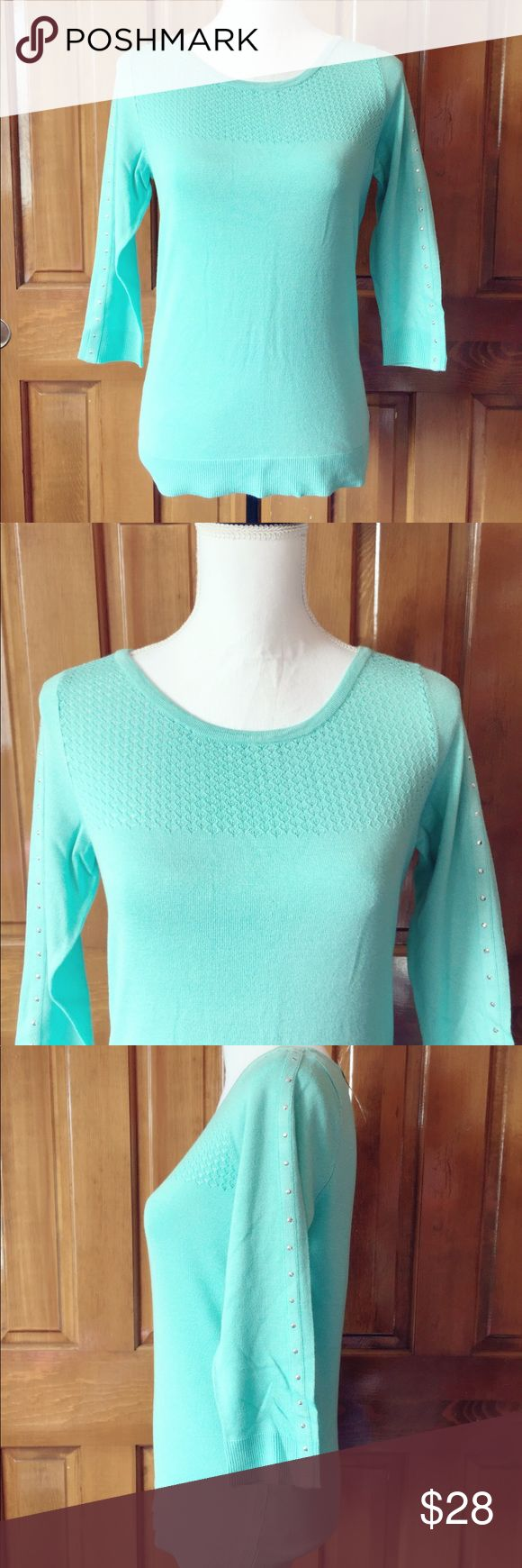 "NEW YORK & COMPANY 7th AVENUE STUDDED SWEATER NWT. NEW YORK & COMPANY 7th AVENUE STUDDED SWEATER SMALL   MEASURES APPROXIMATELY 23"" IN LENGTH. BUST APPROXIMATELY 17"". 3/4 LENGTH SLEEVES. TEAL IN COLOR. New York & Company Sweaters Crew & Scoop Necks"