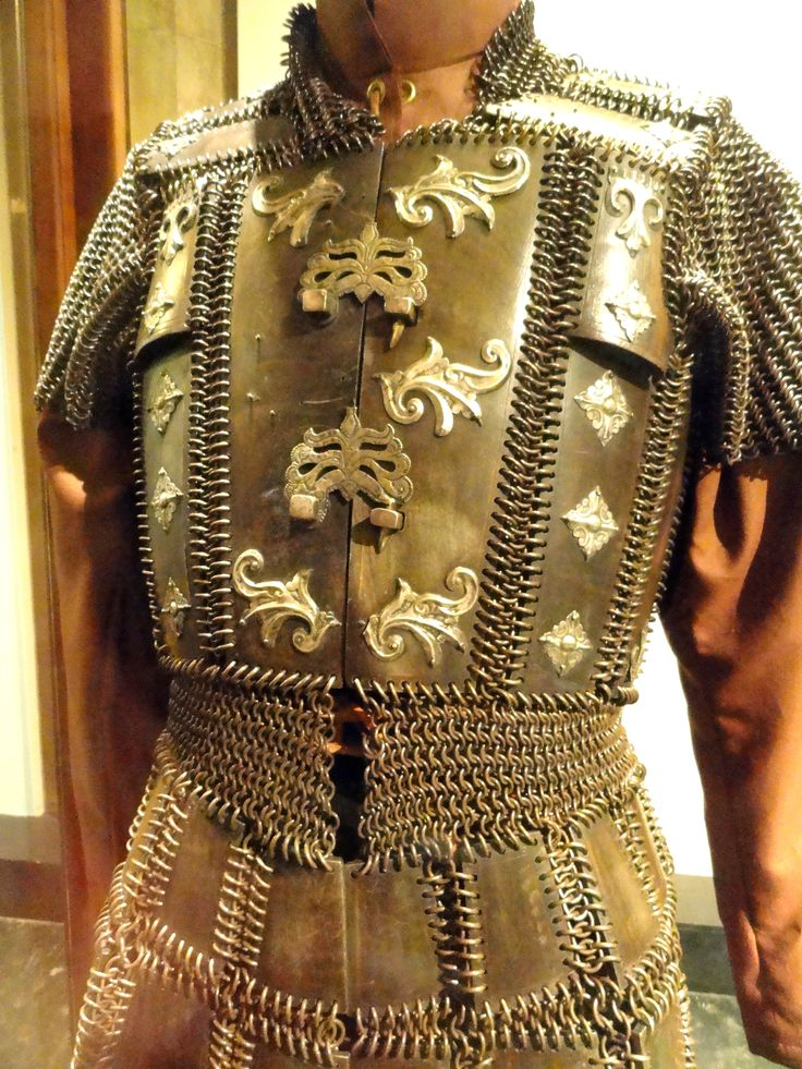 Moro (Philippine, Mindanao) mail and plate armor, 19th century,  brass, carabao horn (Philippine buffalo), silver, protection for the upper part of the body, exclusive to the Moro as it was not found among any other Philippine groups. This armor known as kurab-a-kulang is made of a thin layer of carabao horn, joined with butted brass mail.The front part is closed with wrought hooks,  Higgins Armory Museum.