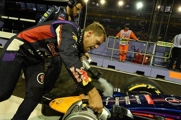 Sebastian Vettel (GER) Red Bull Racing RB10 stopped in pit lane in FP1. Formula One World Championship, Rd14, Singapore Grand Prix, Marina Bay Street Circuit, Singapore, Practice, Friday, 19 September 2014