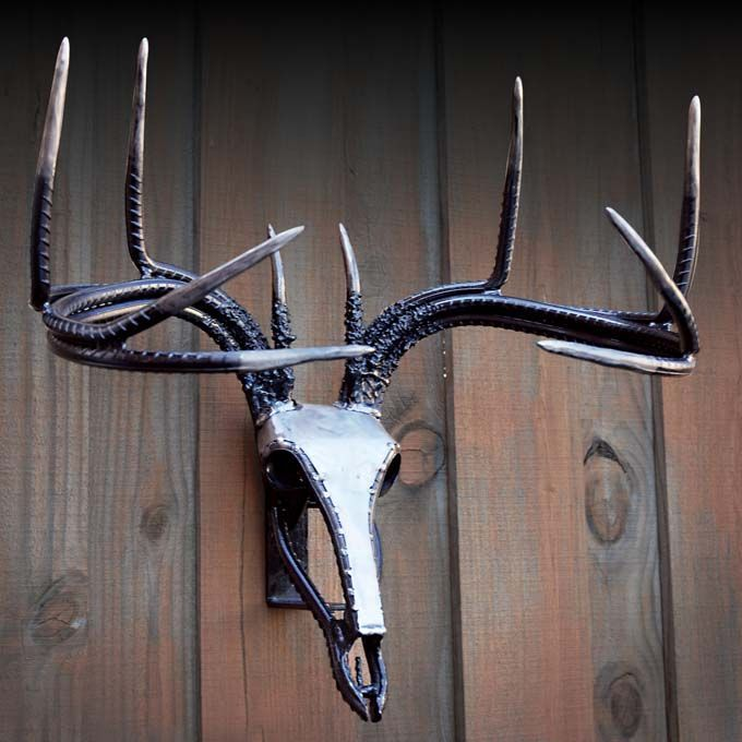 Steel Deer Mount This ferocious whitetail mount is a monster 10-point with a steel skull and a rebar rack. You won't find this mount's equal anywhere. This piece is specially packaged and protected to ensure safe delivery.