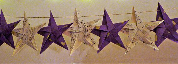 """This origami paper stars garland makes fabulous, shabby chic bunting for anywhere in the home. 20 handmade stars of rustic purple paper with cute gold hearts, and vintage white church organ music sheets alternate on a gold thread to make a cheerful accent for your home. The whole garland measures approximately 55""""/140cm and has loops at each end for hanging. £16.50 inc shipping to Europe/USA/Canada"""