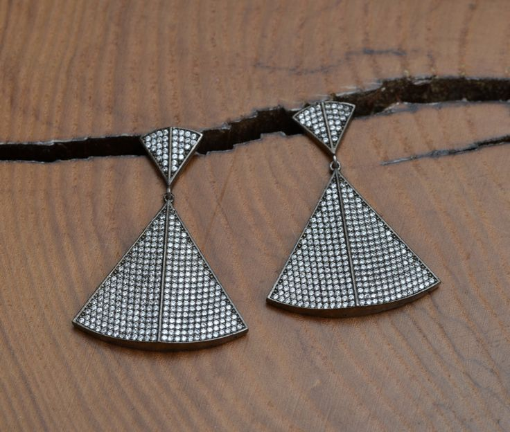 A personal favourite from my Etsy shop https://www.etsy.com/listing/279408644/silver-sparkling-pyramide-earrings
