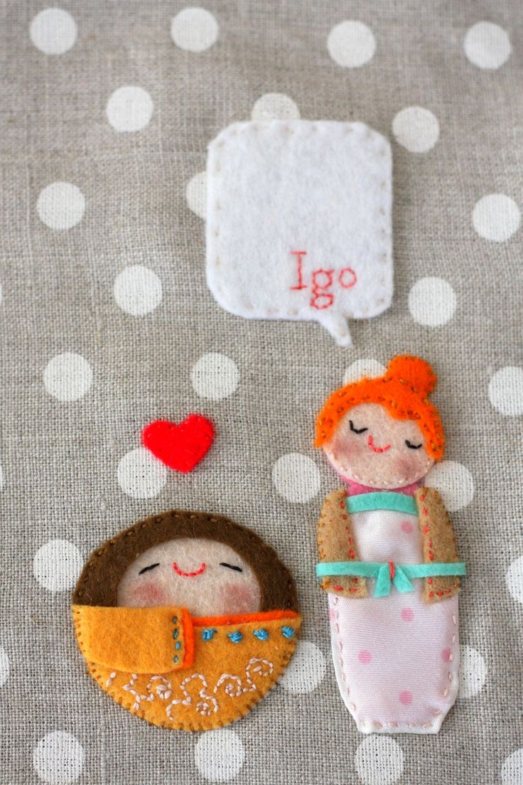 Felt kokeshi dolls on a linen book cover. A great idea for a gift!