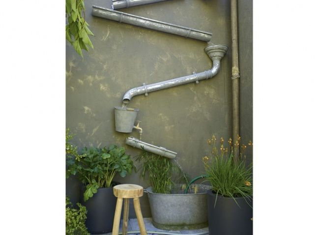 Former gutters fixed to this garden wall and tilted slightly create an innovative rainwater recovery system. | Via maison-deco.com