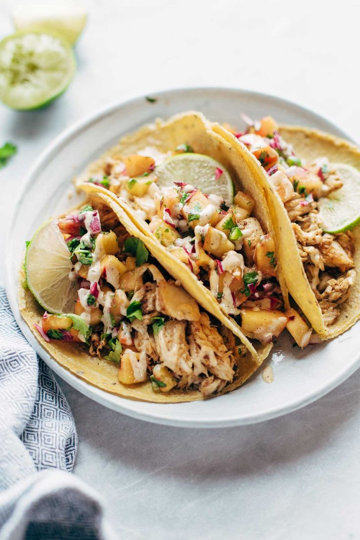 Chili Lime Fish Tacos - mind-blowingly delicious and easy. 5 basic ingredients for the fish, and a quick peach salsa to add some color and flavor.