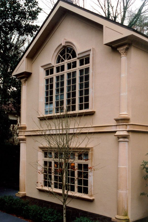 residence with cast stone pilaster columns and midline banding