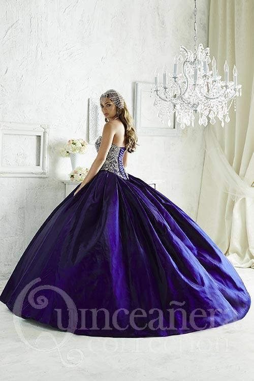Deep-colored satin forms a rich waterfall ball gown skirt, falling from ornate, symmetrical beadwork lavished upon the bodice and sweetheart neckline. Download the Quinceanera Collection by House of W