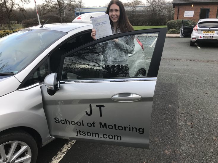 Driving School Telford Many congratulations to Felicity Painter from Donnington on passing her driving test First Time. The examiner obviously liked your drive, because he still passed you after you abandoned the car at the end of the test!! I hope you enjoy driving your car about. Don't have too many squabbles with your mum about who's turn it is though!! Best wishes from your driving instructor John, and all the team at JT School of Motoring https://www.jtsom.co.uk/locations/telford/