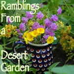 Purple Lantana and Desert Marigold Bouquet in Polish Pottery pitcher.