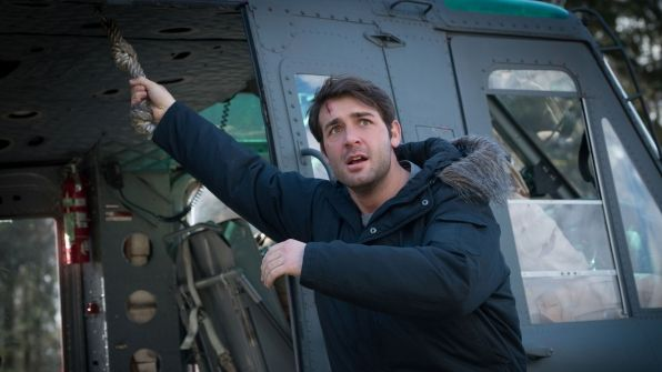 Jackson Oz boards an army helicopter.