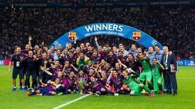 FC Barcelona lift the Champions League Trophy
