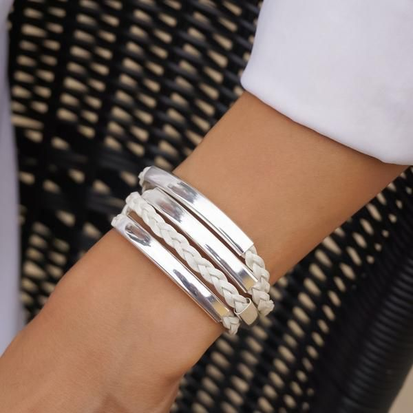 The Mini Addison Braided Wrap in Silverplate featuresa braided leather strand with wide silverplate crescents.Designed to be worn as a bracelet only, handmade