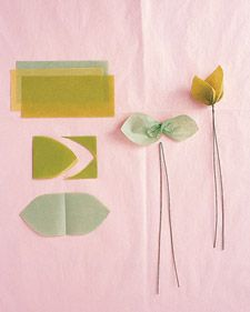 Double Leaf  To make three double leaves, stack tissue in three hues of green. Cut 2-by-3-inch rectangles through all layers; fold in half. Trim tips into points; unfold. Twist each sheet at center. Fold 18-inch floral wire in half, slip over center of leaf, and twist. Fold tips toward each other, and curl.