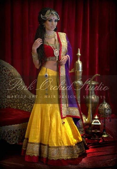 Like color scheme,maybe yellow saree red/orange blouse and purple stole/shael