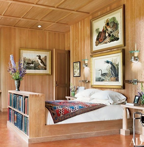 At architect Allan Shope's home in Amenia, New York, site-harvested black cherry clads the walls and ceiling of the master bedroom and is the source of its built-in furniture | archdigest.com
