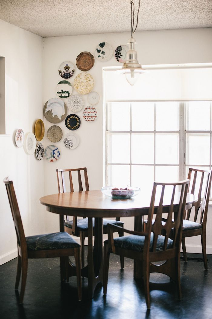 We dig the way this plate display extends across the corner from one wall to the next.
